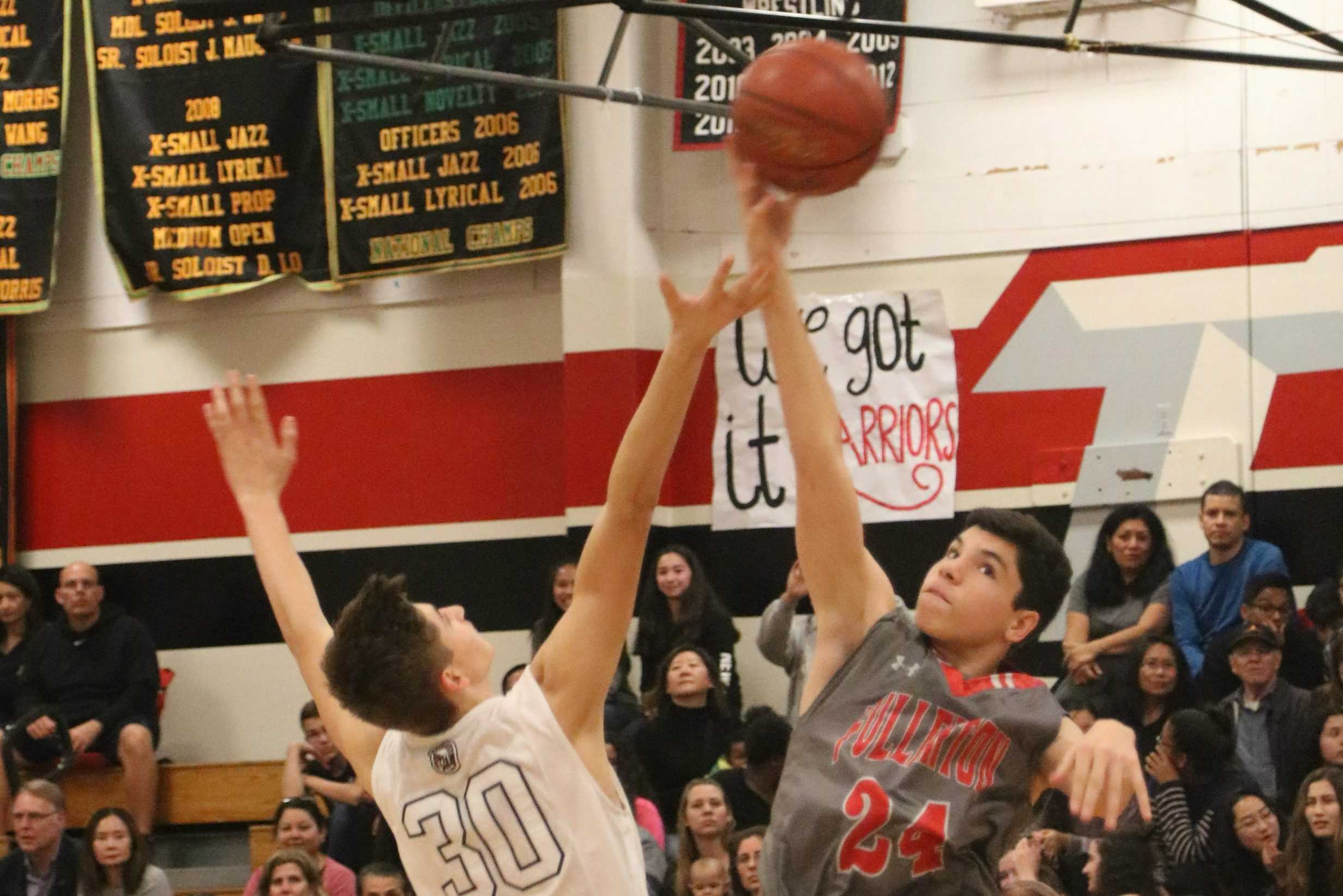Senior Javy Rodriguez jumps for the tip-off. Photo by Emily Caluya.
