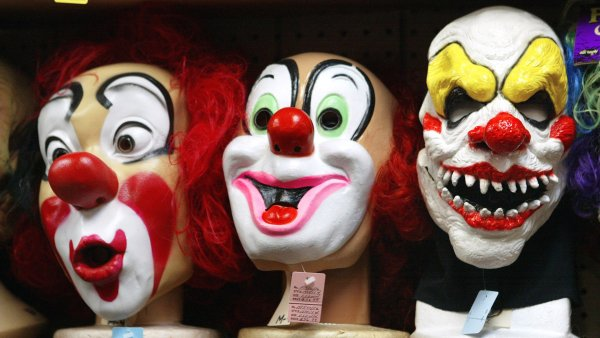 Creepy clown masks. Photo by Tim Boyle/Getty Images.