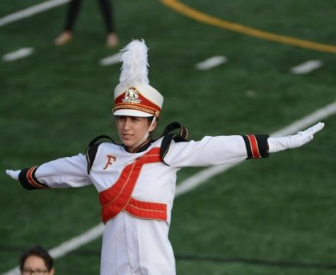 Rebecca De Leon saluting the judges at the last band competition on Oct. 29. Photo by Helen Craft.