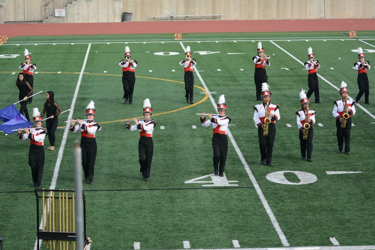 """The band performs their show """"Imprints"""" at the Newport Harbor Open Tournament. Photo by Helen Craft."""
