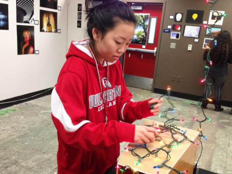 Kimoto adding festive lights to one of her art projects.