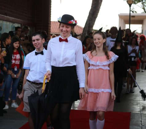 (left to right) Logan Manjarres, Kimberly Thibodeaux, and Emma Brown dressed up as Mary Poppins Characters.