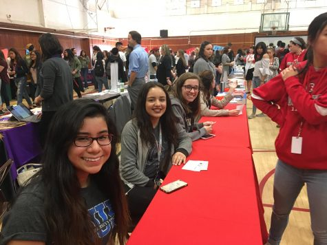 ASB students Katelyn Gomez, Kaylee Nelson, and Angela Lankenau, pose while helping students at the College and Career fair