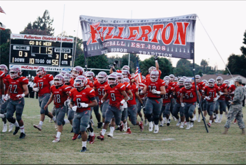 Fullerton football running out on the field. Photo by Megan Kim.