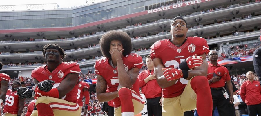 Colin+Kaepernick+and+his+teammates+take+a+knee+to+protest+racial+inequality.+Photo+courtesy+of+%40circa