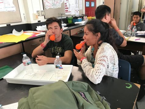 Students at a STEAM  meeting doing a Halloween stressball project. Photo by Gillian Hodgden.