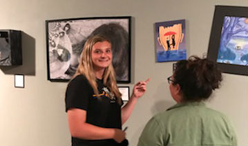 FUHS students admire the artwork in the gallery. Photo by Maggie Crail.