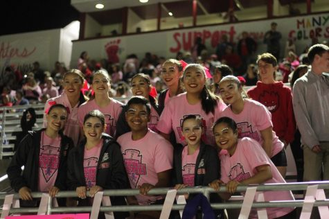 The Indiancers show their school spirit at the Tackle Cancer game.