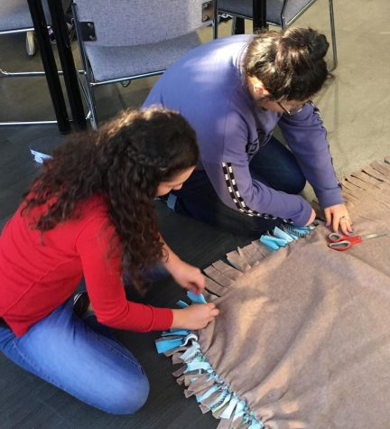 NHS members make no-sew blankets to give to children. Photo courtesy of Mike Muhovich.