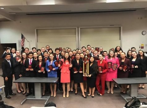 The Speech and Debate team poses with their first place trophy. Photo courtesy of Priscilla Merit.