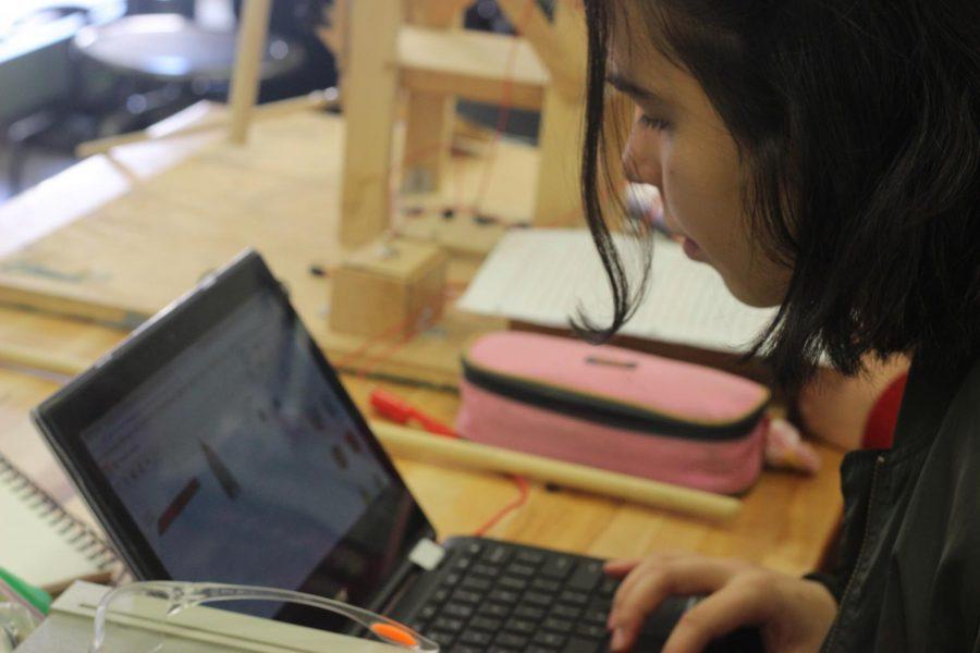 Erika Pike-Gonzalez working on her chromebook
