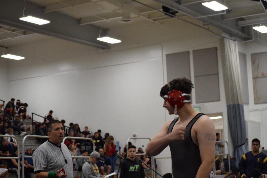 Senior Tyler Mollenkramer sizes up his opponent. Photo by Josh Hansen.