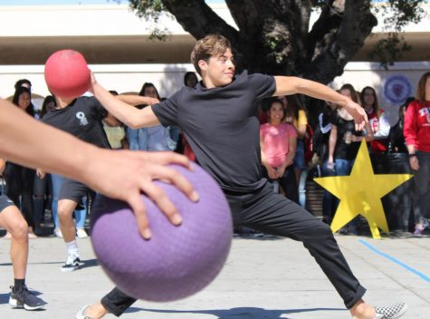 Senior Taylor Garcia throws a ball. Photo by Cordelia Tran.