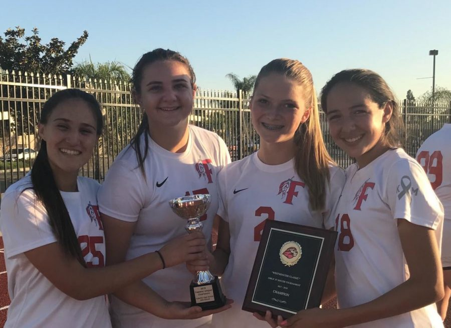The girls JV Soccer captains are proud of their teams accomplishments over the last season. Photo courtesy of Sierra Pike.