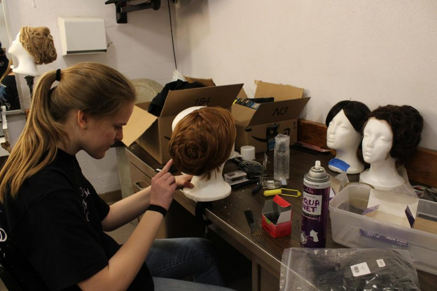 Olvia Kehoe works on the wigs for the show. Photo by Melanie Pinzon