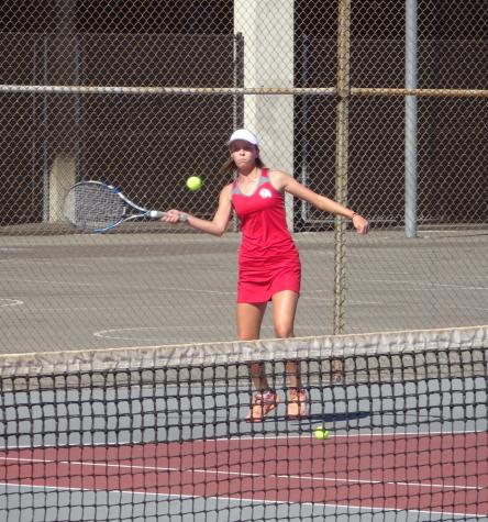 Eliza Lynch launching the ball during a match