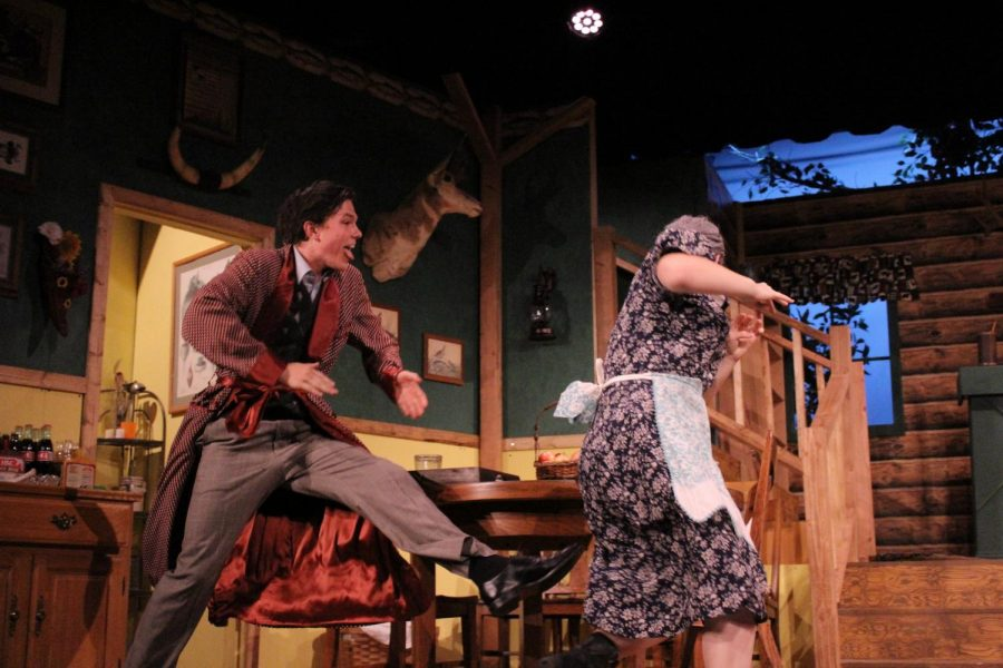 Devin Ricklef (Charlie) chases Isley Duarte (Betty) around the table to show that he enjoyed his meal.