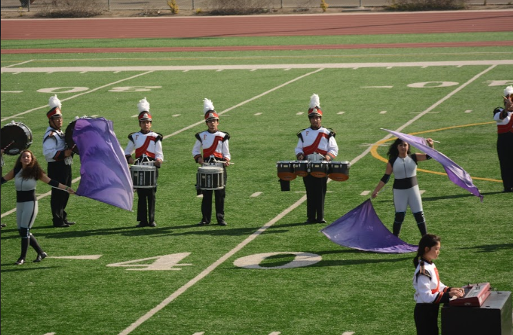 The band and color guard perform.