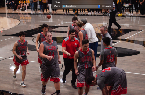 The team walks towards the sideline during a timeout. Photo courtesy of Kylen Campbell
