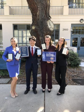 (in order from left to right) Tran, Kwon, Basham, and Wright with their tournament plaques.  Photo courtesy of Emily Markussen.