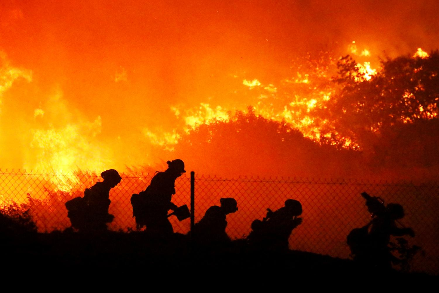 Firefighters working to contain the Saddleridge Fire in the San Fernando Valley. Photo courtesy of Associated Press.