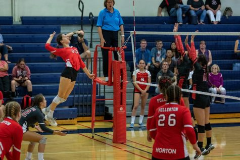 Junior Vanessa Chavez had 19 kills and three blocks in the first League win against Troy.