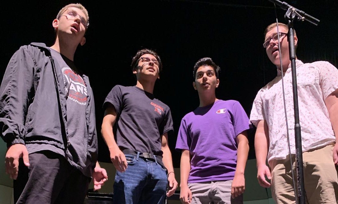"The barbershop quartet Nothing Rhymes with Orange will sing ""Can You Feel the Love Tonight"" from the Disney film The Lion King. In order from left to right, junior Ryan Simpson, and seniors Elias Beltran, Elijah Brandquist, Cooper Miller rehearse for tonight's concert. Photo by Jeanmarco Flores."