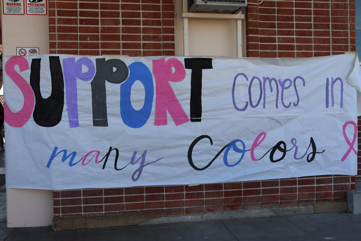 ASB decorated the campus with uplifting posters and interactive Stomp Out bubble wrap sheets to promote cancer awareness. Photo by Jose Perez.
