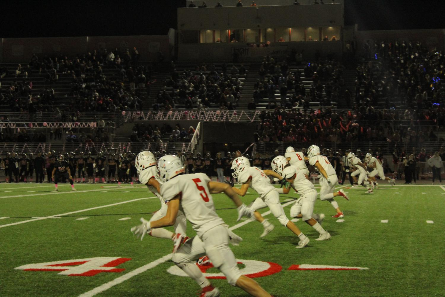 Senior Michael Fernandez kicks off the second half in the 28-21 win against Troy. Photo by Isaiah Zarate.
