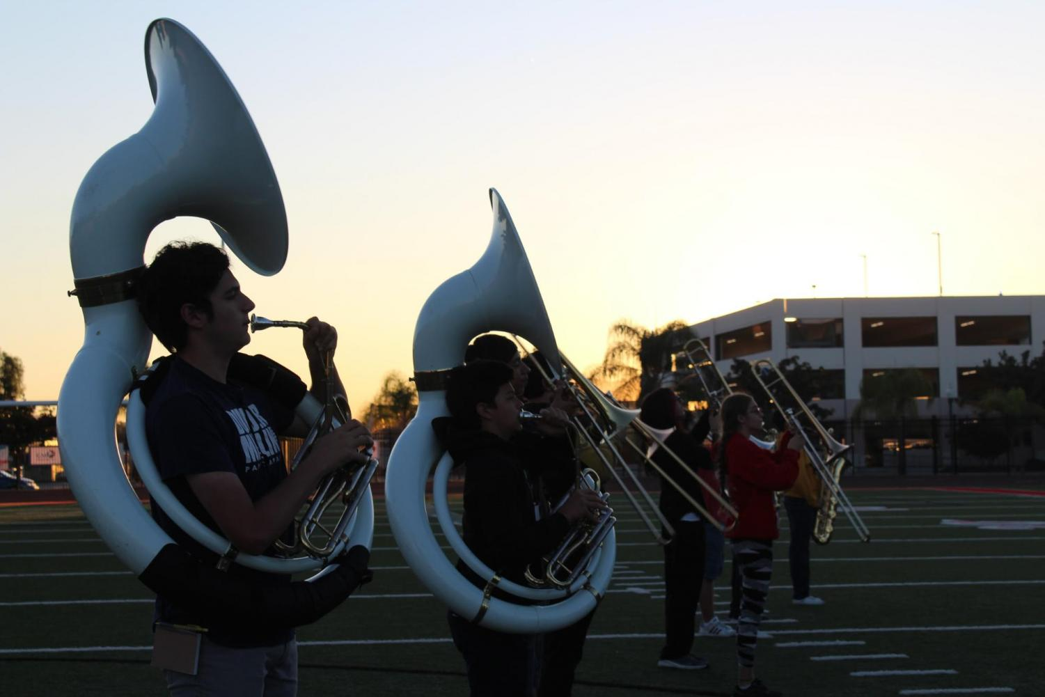 Sophomores Jameson Oates and Chris Rodriguez play the tuba while Sophomore Caleb Sutter and Freshman Leah Chappell play the trombone. Photo by Betsy Barreto.