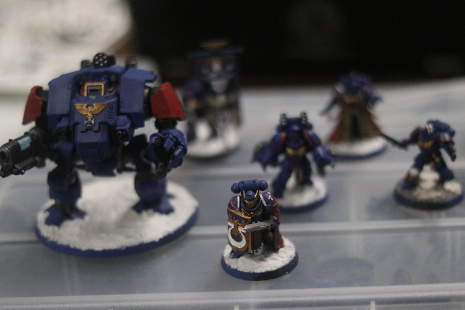 """A collection of Warhammer figurines from the same army. These troops are from the """"Astra Militarum"""" army, though their color is junior Timothy Dinh's decision. Photo by Jose Perez."""