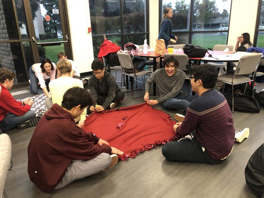 NHS club members tie blankets for Project Linus on Dec. 6.