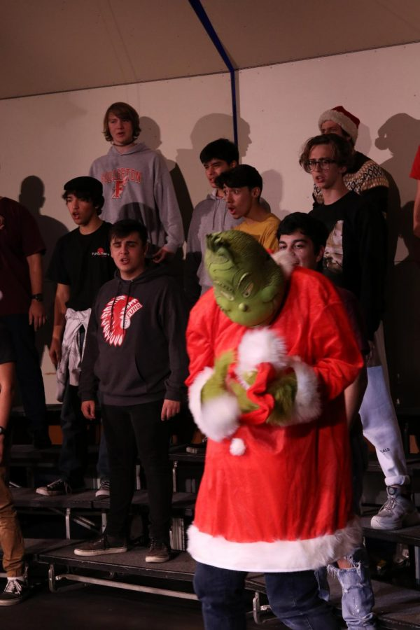 Cooper+Miller+portrays+the+Grinch+at+a+choir+rehearsal+on+Wednesday+in+preparation+for+Thursday%27s+show.