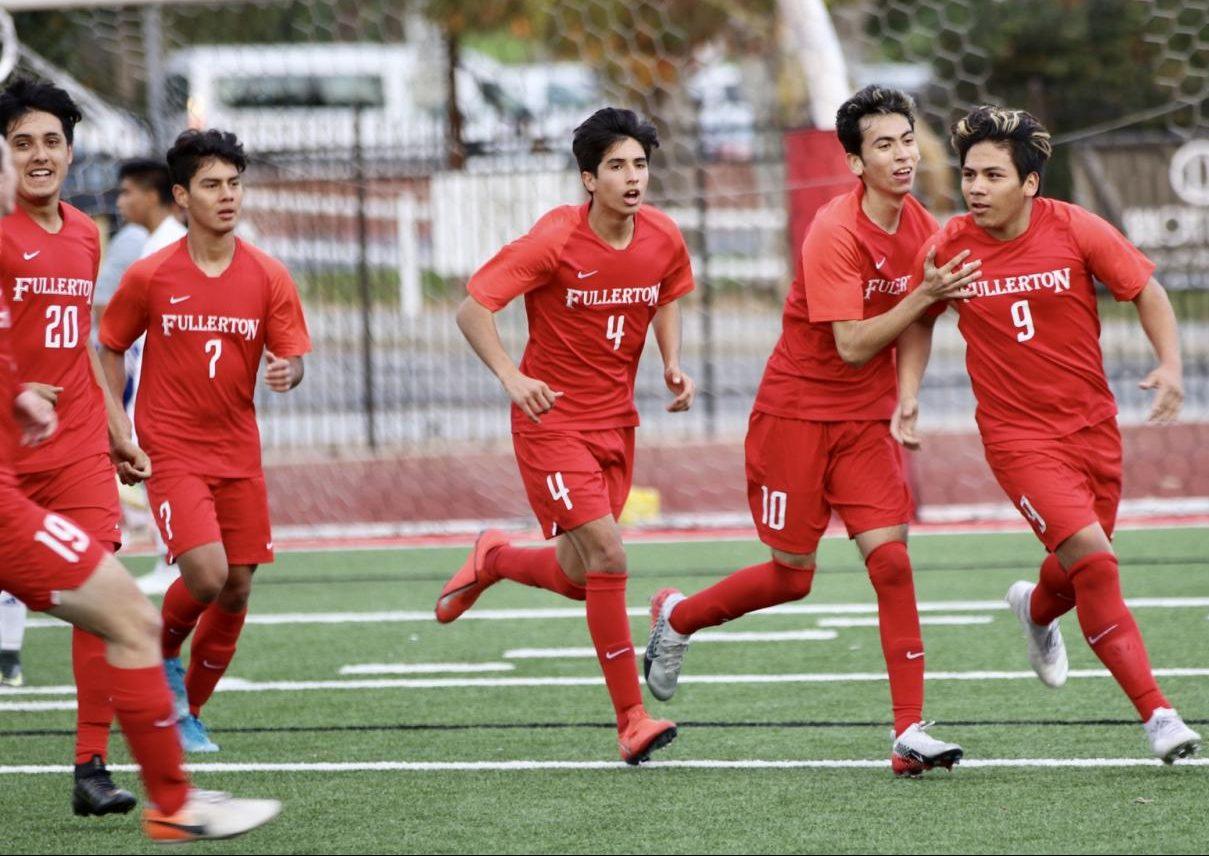 The boys soccer team celebrates Joseph Espinoza's goal in the 3-1 win against La Habra on Jan. 8. Photo by Jose Perez.
