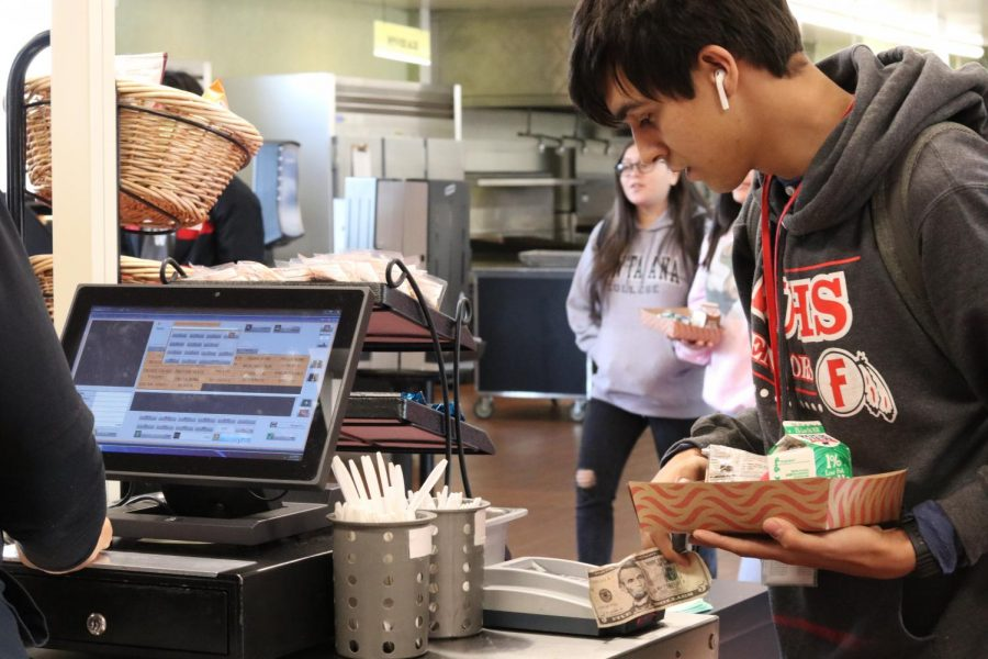 Senior Phillip Fisher enters his ID number to pay for lunch. Photo by Betsy Barreto.