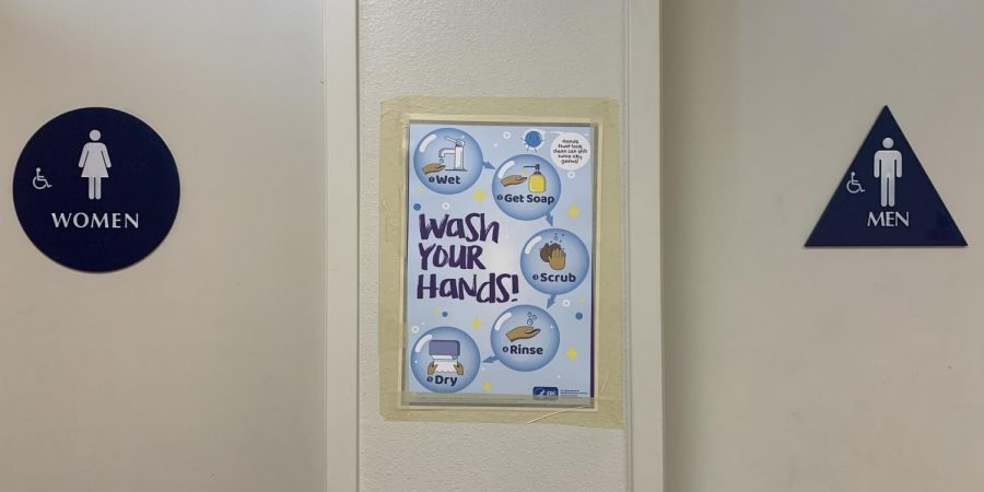 Teachers received new posters highlighting the importance of personal hygiene. Photo by Gillian Hodgden.