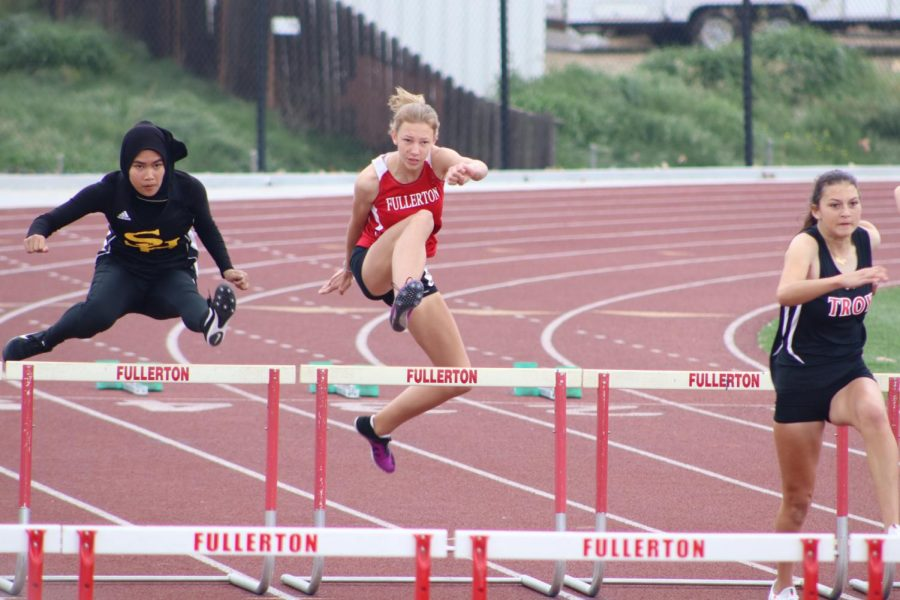 Sophomore+Natasha+Pavalek+jumps+the+first+hurdle+in+the+varsity+100+meter+high+hurdles+event.+Photo+by+Jose+Perez.