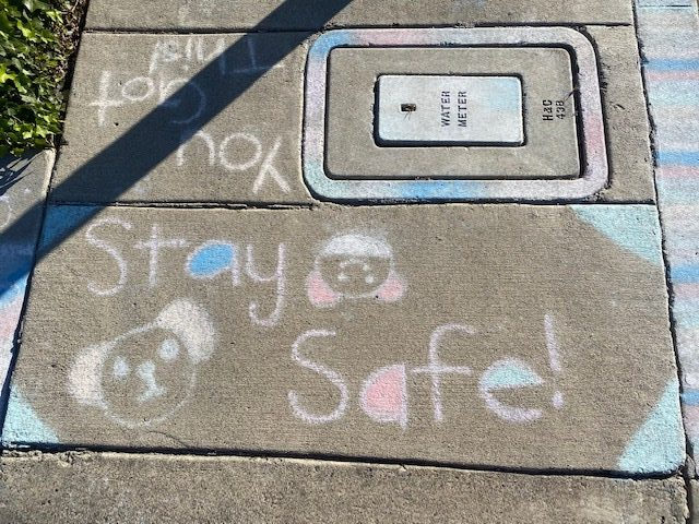 Chalk drawings provide encouragement to neighbors and friends. Photo by Alexandra Williams.