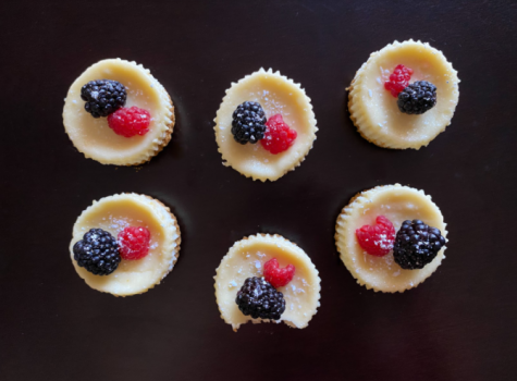 Mini cheesecakes topped with berries and a sprinkle of powdered sugar. Photo courtesy of Veronica Gonzalez.