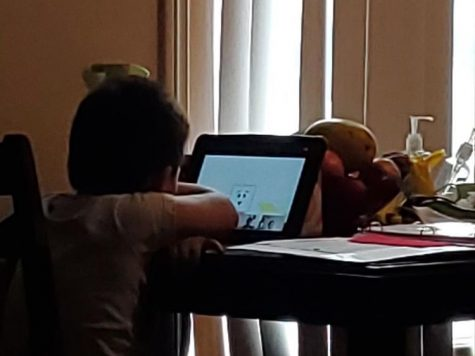 Ian, age 4, works on his iPad for his Pre-K class. Photo courtesy of Alexia Ocampo.