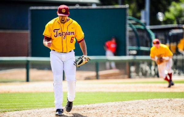 Coach Kyle Davis received a full scholarship to pitch for USC.