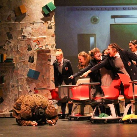 A crushing heartbreak for the theater department was the March 13 cancelation of Matilda. Junior Nate Baesel is on the floor while (from left) Madeline Lange, Haley Cronin, Ryder Tucker, and Allie Jeha play their roles as bullying school children. Ryder said that locking down right before opening night was hard for freshmen who were just gaining momentum in theater arts. Photo courtesy of Ryder Tucker.