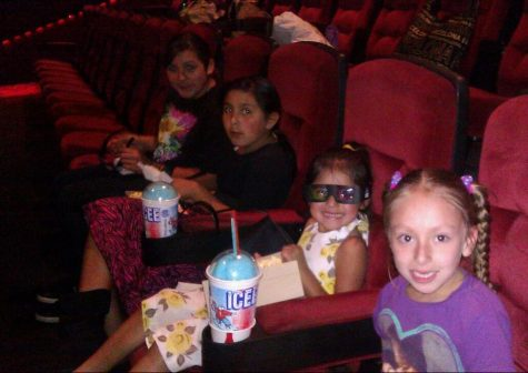 Elany Zavala (center with 3D glasses) watched the 2011 Justin Bieber movie with her two sisters and cousin.
