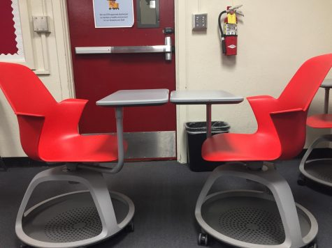 These student desks are too close together. If you're not staying 3 feet apart then you should be staying more than 3 feet apart. Photo illustration by Desi Garcia.