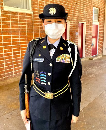 Alejandra Valencia Rojas often helps JROTC cadets prepare for uniform inspections. Photo courtesy of Alejandra Valencia Rojas.